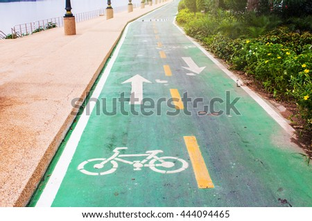 Bicycle symbol on street, bike lane in the park. - stock photo