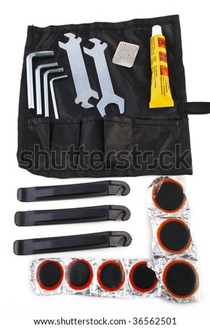 bicycle tools for emergency repairs isolated on white background - stock photo