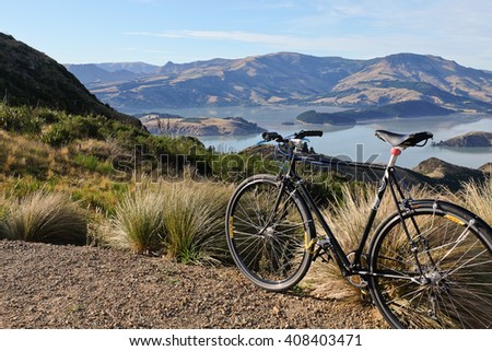 Bicycle Trail in The Hills Overlooking The Harbor. The Port Hills, Christchurch, New Zealand. - stock photo
