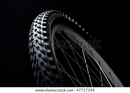 bicycle tyre on black background