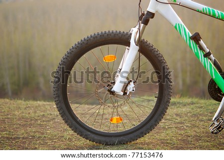 Bicycle wheel on top of cliff - stock photo