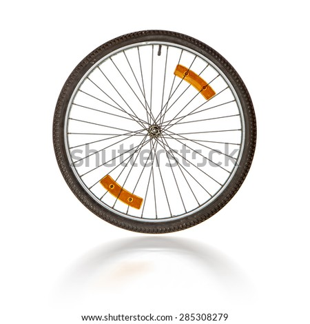 Bicycle wheel with shadow over white - stock photo