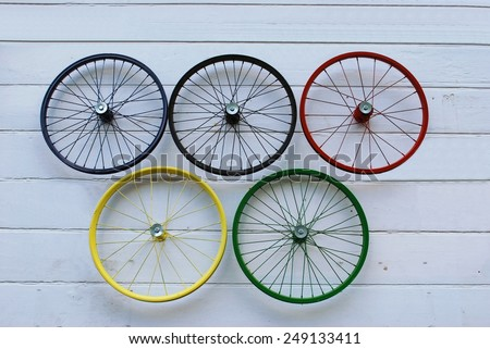 Bicycle wheels as olympic symbol - stock photo