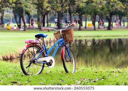 Bicycle with beautiful spring near lake. - stock photo