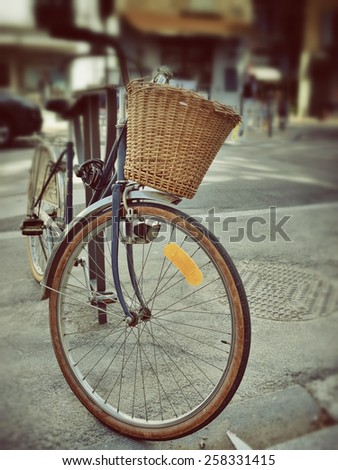 Bicycle with shopping basket on the street in Avignon, Provence, France. Filtered image, vintage effect applied. Blurred corner and toned- old lens style - stock photo
