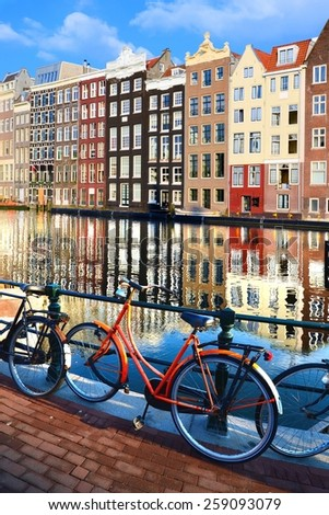 Bicycles along beautiful canals with reflections, Amsterdam, Netherlands - stock photo