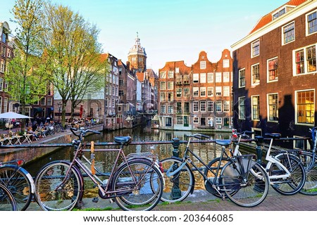 Bicycles along the canals of Amsterdam, Netherlands - stock photo