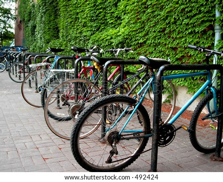 Bicycles in rack - stock photo