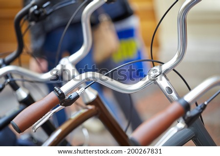 Bicycles in the parking lot, a fragment with shallow depth of field - stock photo