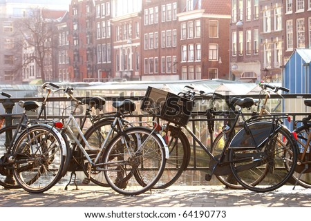 Bicycles on a bridge in Amsterdam - stock photo