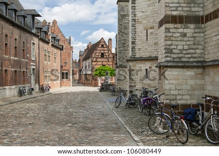 Bicycles parked next to the walls of old houses in Grand Beguinage of Leuven - stock photo