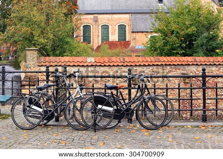 Bicycles parking on an old cobblestone Europe road - stock photo