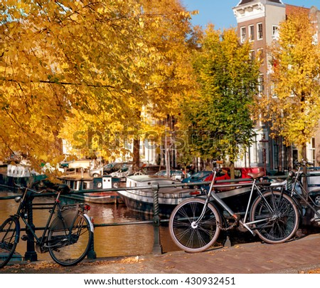 Bicycles standing near Amsterdam canals in autumn