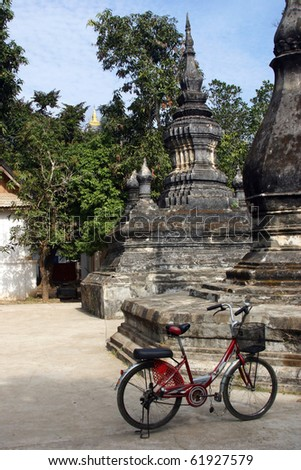 Bicycling in Luang Prabang, a UNESCO World Heritage Site - stock photo