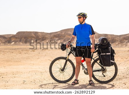 Bicyclist rides on the road - stock photo