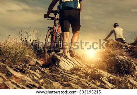 Bicyclist travelers in mountain - stock photo