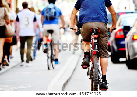 Bicyclists in traffic - stock photo