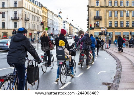 Bicyclists on road in Copenhagen. - stock photo