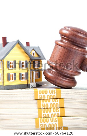 Bidding on a home on isolated white backgorund - stock photo
