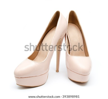 Biege high heel woman shoes isolated on a white - stock photo