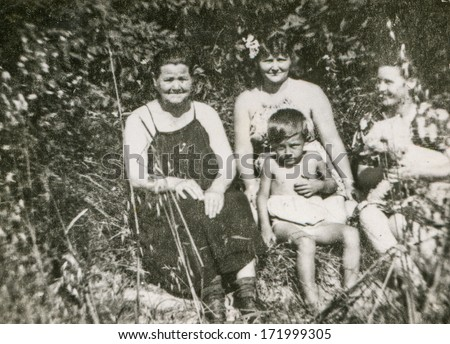 BIELSKO, POLAND, CIRCA 1940s - vintage photo of happy family outdoor