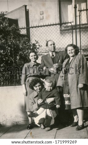 BIELSKO, POLAND, CIRCA 1940s - vintage photo of happy family with a child outdoor