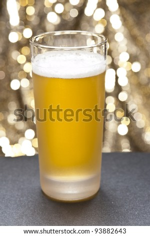 Bier glasses in front of a colorful background with little decoration - stock photo