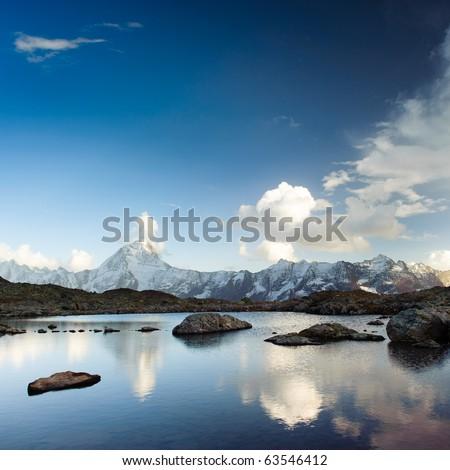Bietschorn mountain peak reflecting in small lake, Loetschenpass, Wallis, Switzerland - stock photo