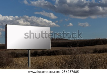 Big advertising billboard and cloudy sky background - stock photo