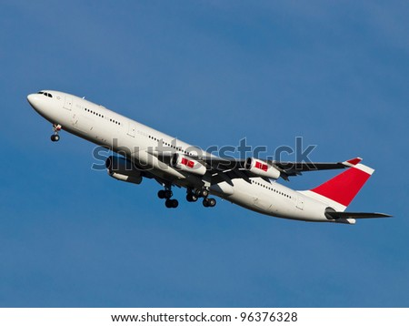 big aeroplane landing on the airport - stock photo