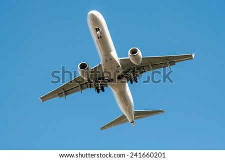 Big airplane in the sky - Passenger Airliner aircraft  - stock photo