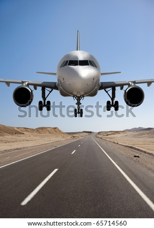 Big airplane ready to land - stock photo