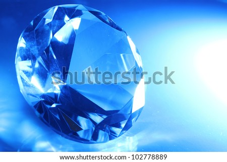 Big and beautiful jewel in blue light - stock photo
