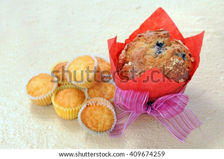 big and mini muffins on table for holiday decoration - stock photo