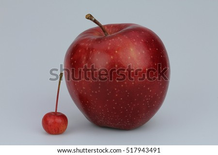 Big and small red apples
