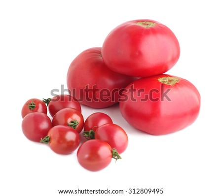 Big and small ripe red tomatoes on white isolated