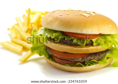 Big and tasty hamburger and fried potatoes isolated on white background