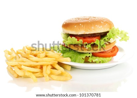 Big and tasty hamburger on plate and fried potatoes isolated on white - stock photo