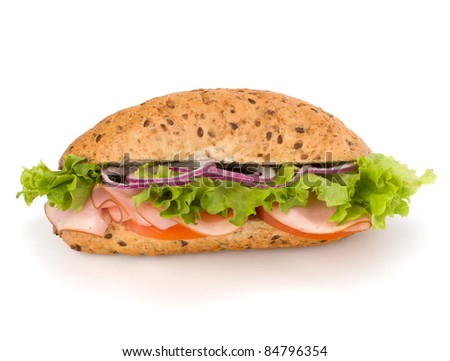Big appetizing  fast food baguette sandwich with lettuce, tomato, smoked ham and cheese isolated on white background. Junk food .