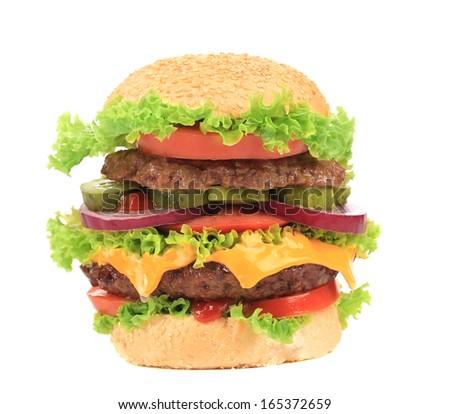 Big appetizing hamburger. Isolated on a white background. - stock photo
