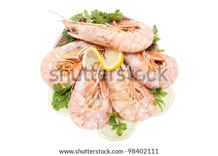 big appetizing tiger shrimps with lemon slice and parsley