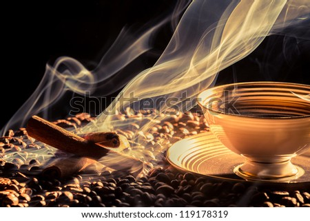Big aroma of coffee from little cup - stock photo