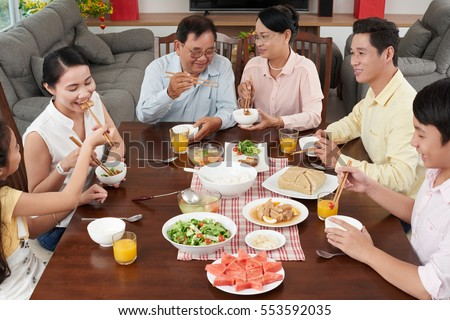 Big Asian family enjoying traditional food for Tet celebration