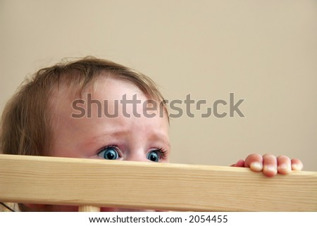 big baby eyes with fear in his look - stock photo
