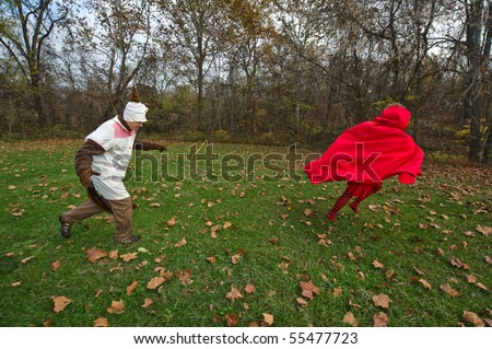 Big Bad Wolf Chasing Little Red Riding Hood - stock photo