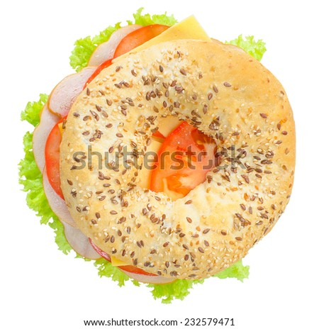 Big bagel sandwich with tomato cheese and ham on white background  - stock photo