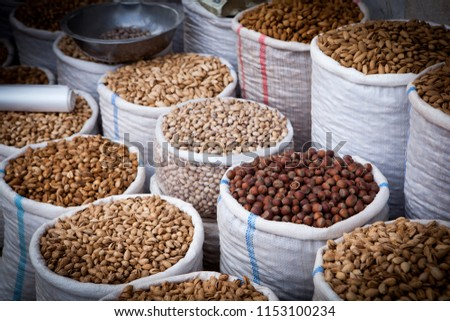 Big bags with nuts and grains at Samarkand Market. Selective focus