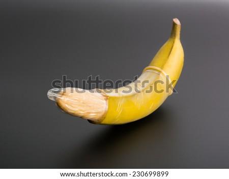 Big banana with condom - stock photo
