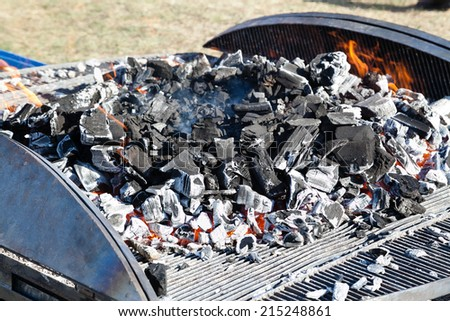 Big barbecue grill with burning charcoal and selective focus - stock photo
