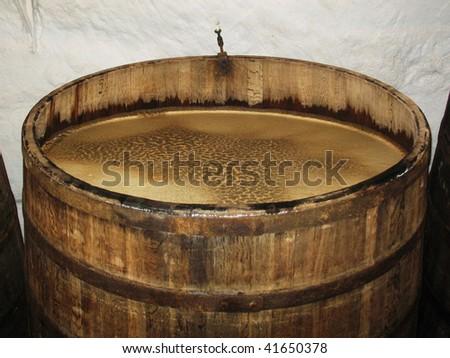 Big barrel full of aging beer in brewery storage Plsen Czech - stock photo